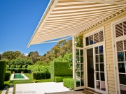 folding-arm-awnings-outdoor-awnings 3.2 outside a house