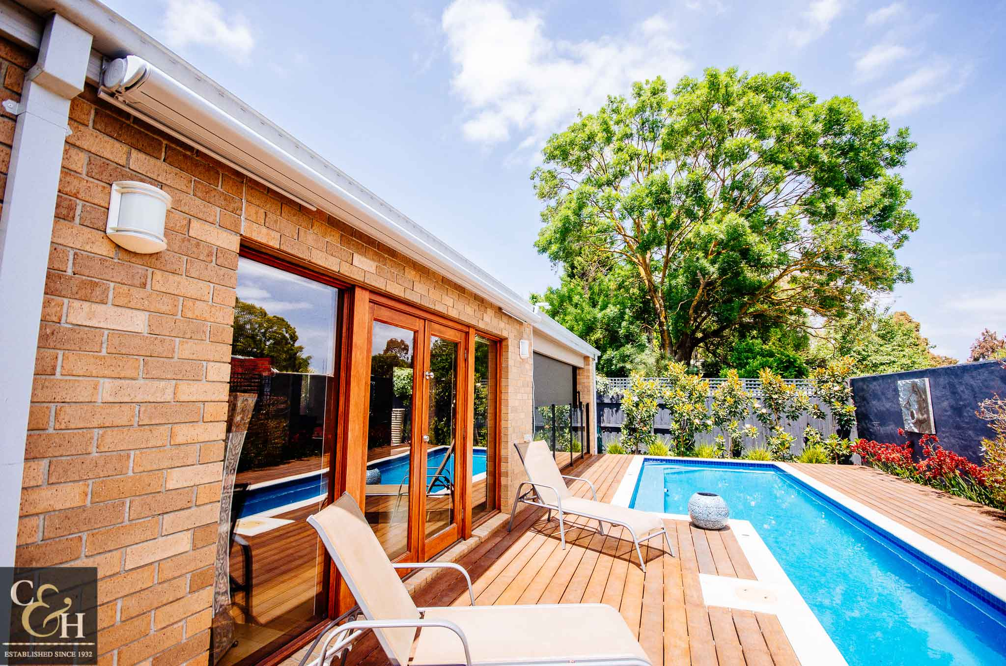 Brustor-B50-Full-Cassette-Folding-Arm-Awnings-11 outside a house