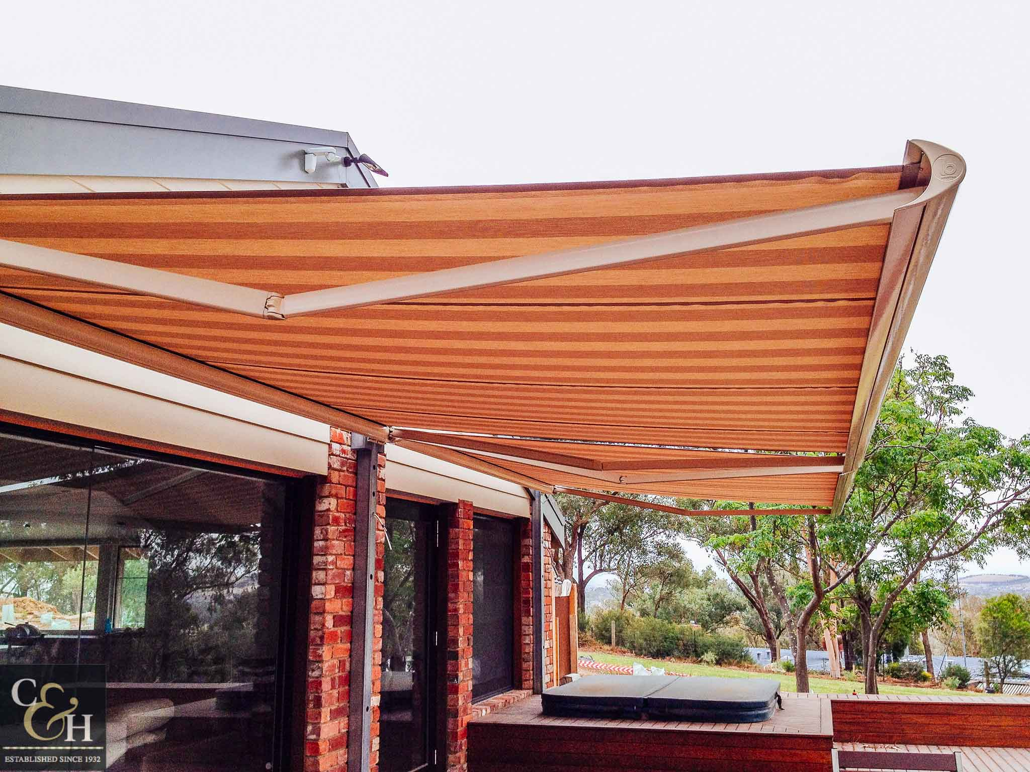 Brustor-B50-Full-Cassette-Folding-Arm-Awnings-5 outside a house