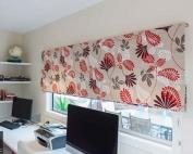 Designer fabric roman blinds 51 on a window.