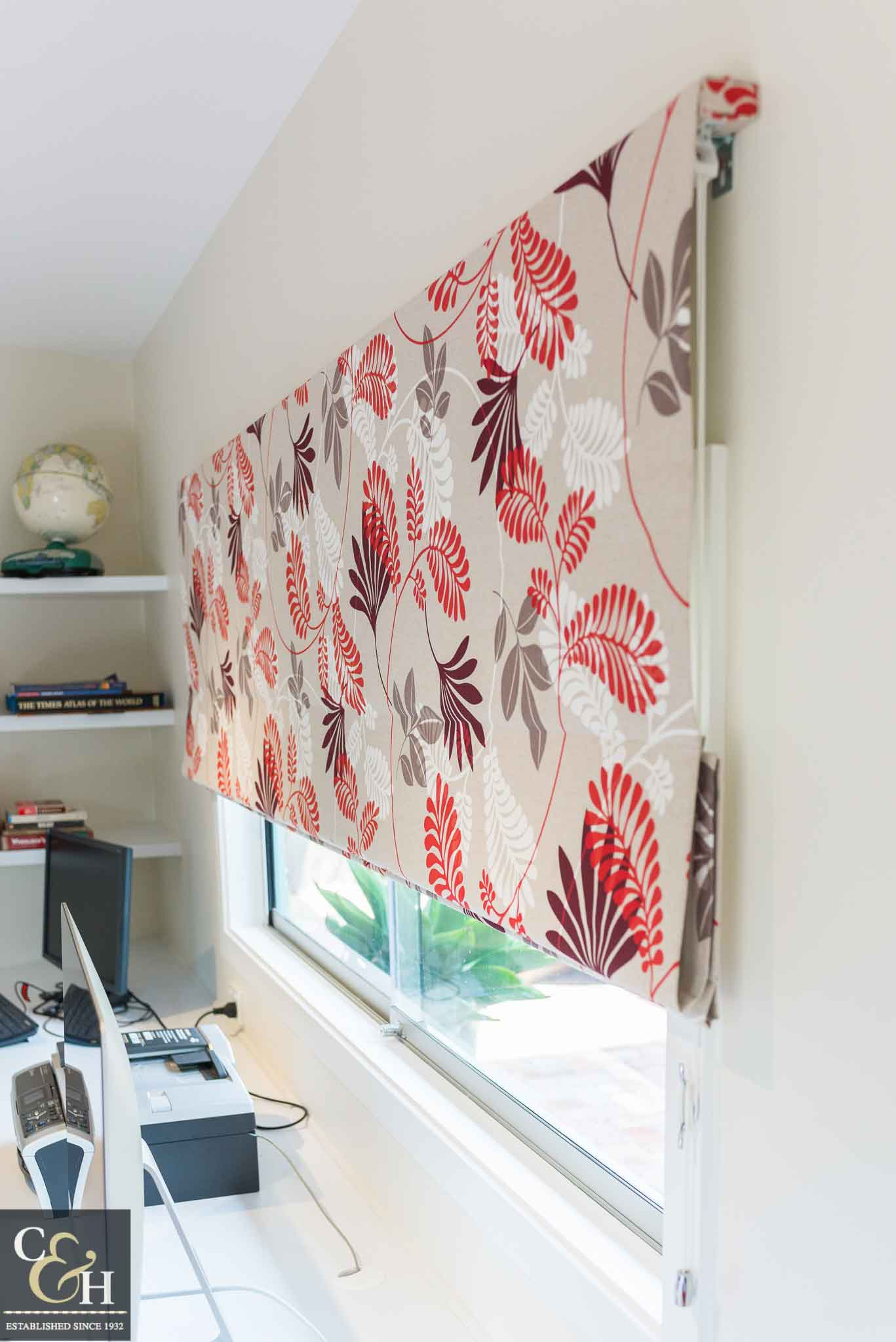 Patterned roman blinds 52 on a window.