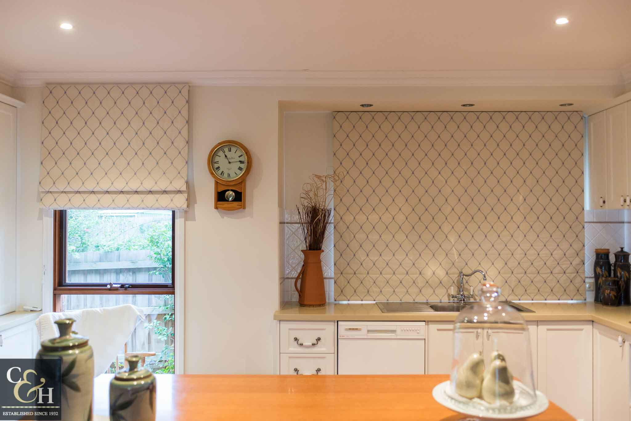 A kitchen with roman blinds 55 on from Campbell & Heeps