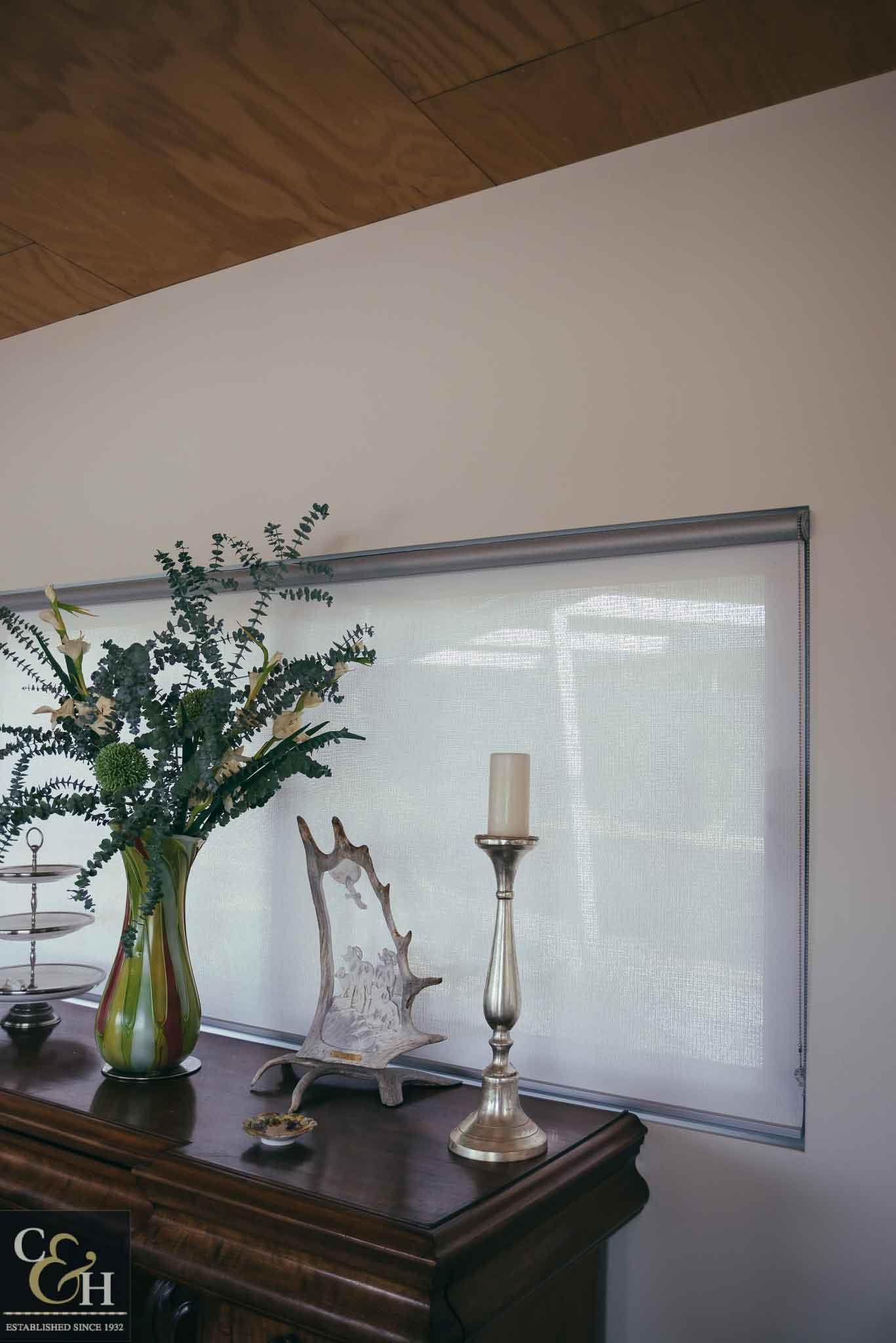 Screen roller blinds 34 inside an apartment