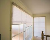 Screen roller blinds 44 inside an apartment