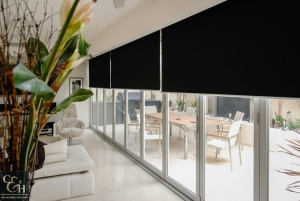 Black Block out roller blinds in a lounge
