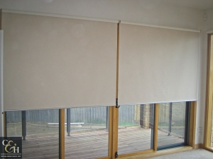Cream and white blockout roller blinds in Melbourne